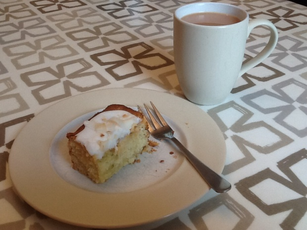 A mug of tea with a serving of coconut and lime cake